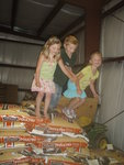 One ton of feed plus straw plus grandchildren = fun